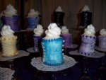Side view of a turquoise corset cupcake