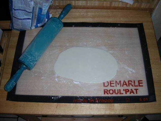 Rolling leftover marshmallow fondant with my silicone rolling pin on my new Roul'Pat