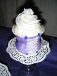 Very curvy full-size purple corset cupcake