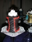 Black icing lacing on the red corset cupcake
