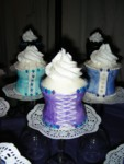 A trio of full-size corset cupcakes