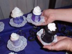 Cyd claims all her favorite purple corset cupcakes!