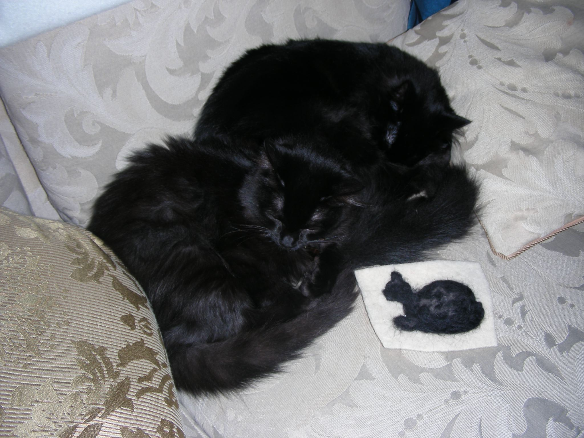 Mom brushed the kitties and used their fur to needle felt onto a freeform black cat. She took a class at Stitches West.