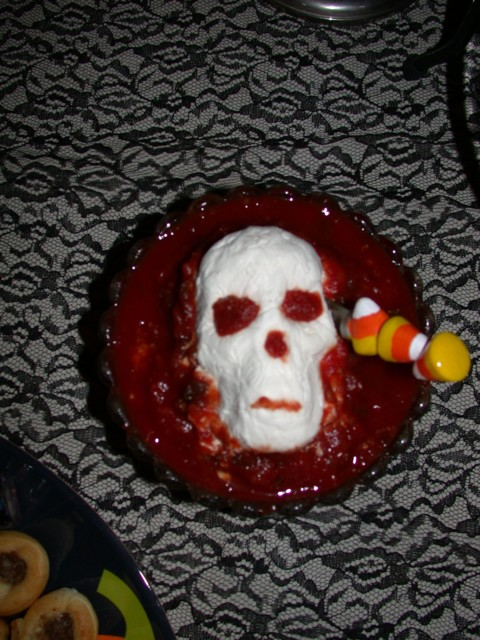 Bloody Bites (cream cheese skull with chili sauce)
