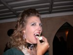 Vampire Britta eats a deviled egg with spider olive, courtesy of Robert & Maureen!