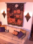Catoween tapestry on the living room wall