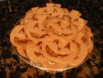 Luminous Lanterns - pumpkin butter sugar cookies with transparent candy features, glowing from a light underneath