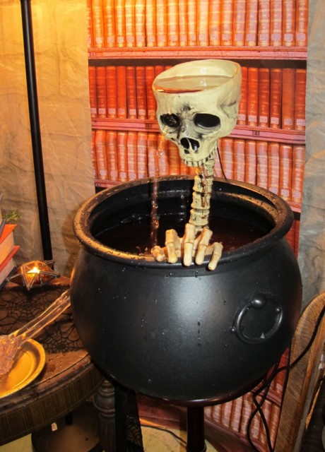 After adjusting the mix to less carbonation since that affects pump performance, the Skull Fountain worked great for awhile with blood-red cran-raspberry juice punch, but the neck brace shifted, spilling the sticky head contents onto the patio...next year will see a better brace system!