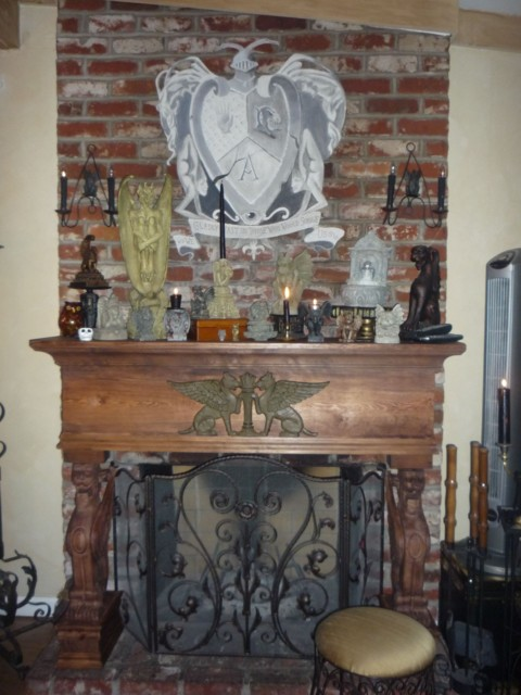 The gargoyles invaded the new custom fireplace mantel almost immediately! Guess they like it there... :)