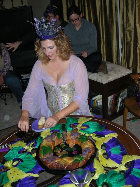 Britta cutting the king cake