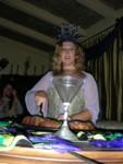 Britta cutting the king cake