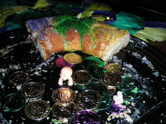 There's the baby with the leftover king cake...leftovers didn't last for long!