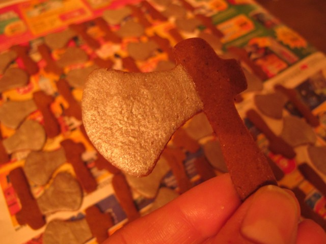 closeup of 12 dozen tiny gingerbread axes, accented with silver luster dust