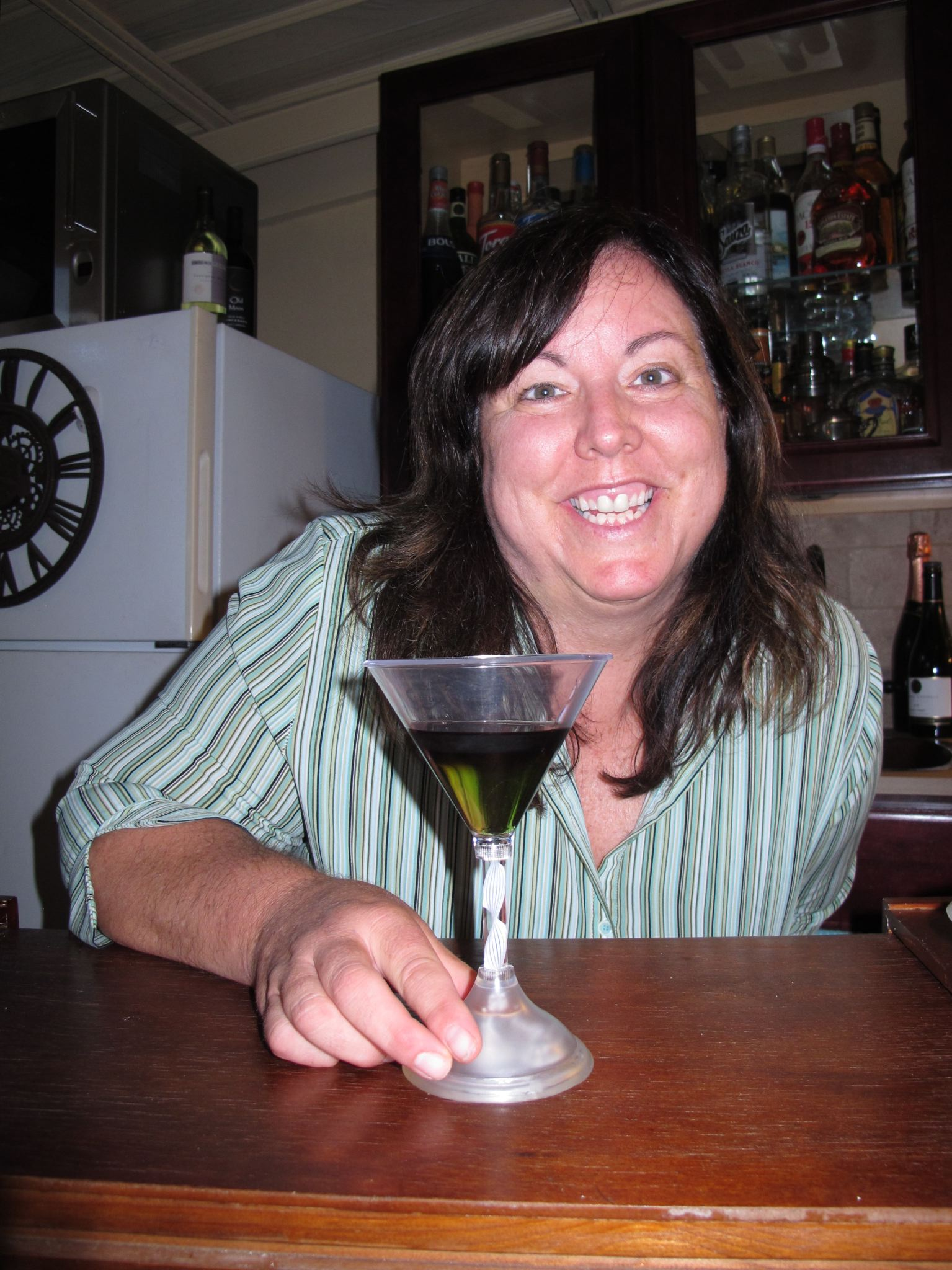 Mary Jo has the first Wicked Witch of the West layered black & green cocktail while she was in charge of the deep fryer!