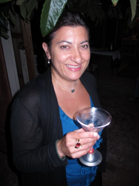 Ruth enjoying her cocktail in a glowing martini glass