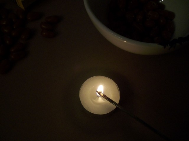 metal skewer tip heated in an open candle flame