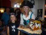 Buccaneer Britta & birthday girl the pirate Lady Ashlyn with her pirate treasure chest cake!