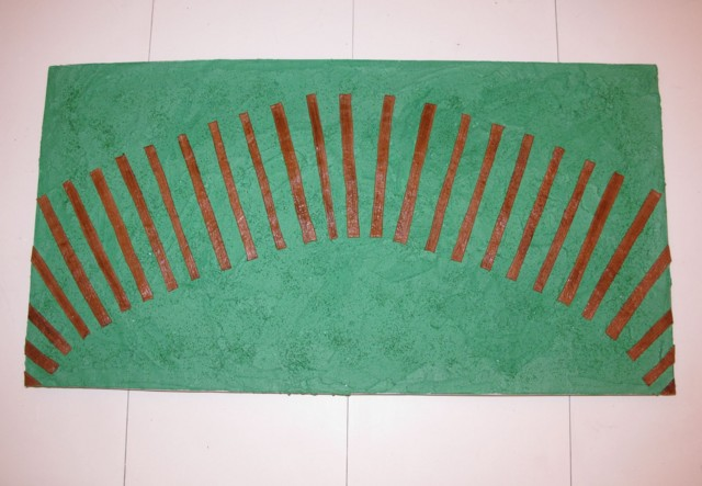 railroad ties in place on green buttercream & sugar grass on a large foil-wrapped foamcore board