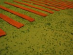 closeup of railroad ties with green sugar grass accents on green buttercream