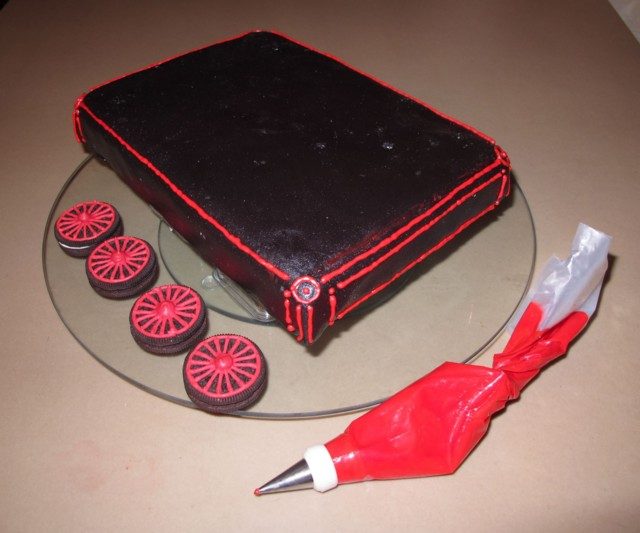 red royal icing accents on the flatbed car to match its wheels