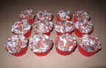 chocolate rock cupcakes in red papers with chocolate buttercream ready as the flatbed car's full load