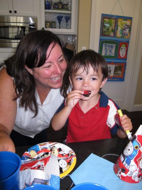 Happy birthday boy nibbles on a wheel!
