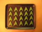 20 clay positive Trek chevrons ready for a new silicone chocolate mold