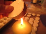pre-toasting the edges of the marshmallow rounds by candle