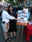 Kevin & Nathania showing us on the poster at the farmers market downtown SLO