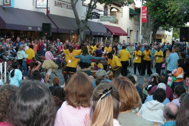 Christ the King Choir from Uganda performing at the farmers market Thursday evening