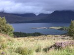 The first horn of Beinn Alligin peeking out from the clouds across Loch Torridon