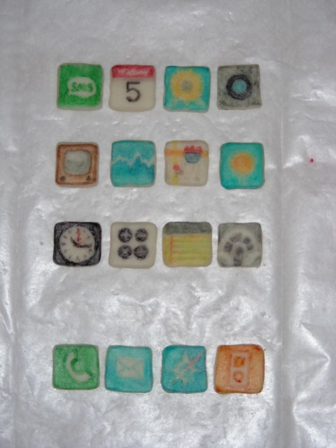 iPhone icons painstakingly painted with food coloring. Painting on chocolate is difficult because the surface is waxy so the liquid beads on the surface. Also I obviously need new fine point brushes (argh! :P ) AND my food coloring pens are all mostly run dry!