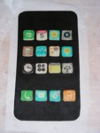iPhone icons arranged on the black chocolate front piece. Note the calendar says 5 since Ruth's birthday is the 5th.