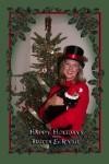 Christmas 2004 - You know I don't like being held - I'd much rather try eating the tree!