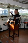 Britta in the captain's chair of the HMS Belfast, doing her best Picard