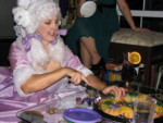 Britta cuts the King Cake