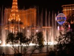 Eiffel Tower across the street with the main Bellagio fountains in front
