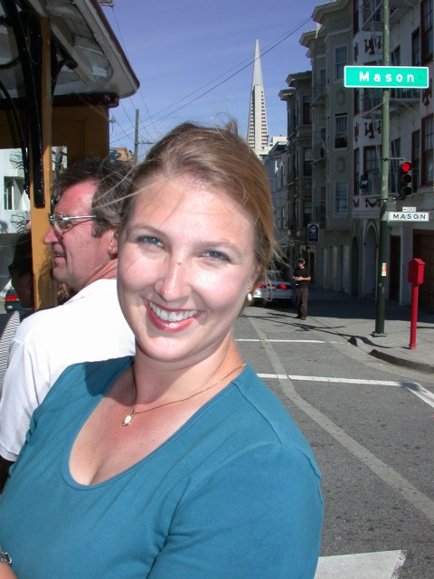 Britta on the cable car with the Transamerica building in the background