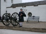 Lady piper playing the bagpipes at Blair Castle!