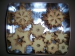 14 dozen snowflake sugar cookies, ready for decorating