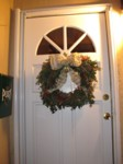 Completely free front door wreath! Boxwood from my hedge, nandina berries from Roseville, white fir trimmings from my Christmas tree